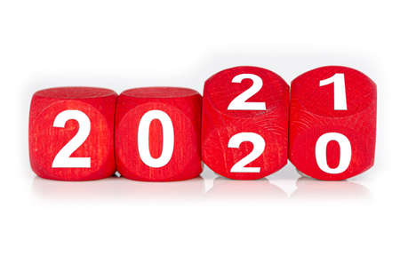 wooden cube with year 2020 and 2021 built from red dices, isolated on white background Banco de Imagens