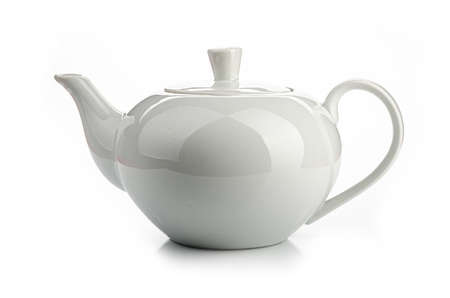 a white teapot on a white background, isolated Banco de Imagens
