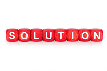 term SOLUTION - built from red wooden cubes on white background, isolated Banco de Imagens