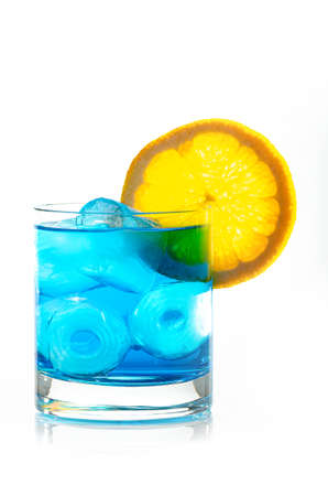 blue drink with ice cubes and lemon on white background, isolated Banco de Imagens