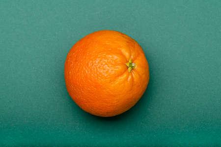 orange fruit on a green background Banco de Imagens