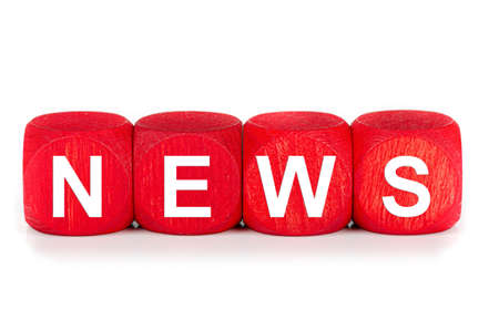 term NEWS - built from red wooden cubes on white background, isolated