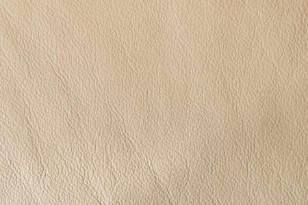 Beige leather background.