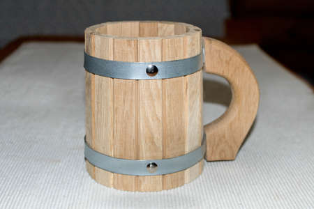 new wooden mug on the table in the bath. Stock Photo