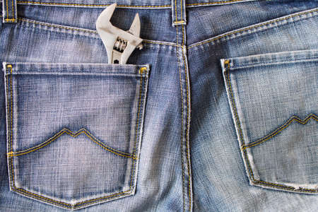 Labor day.  The wrench in the pocket of my jeans . Stock Photo