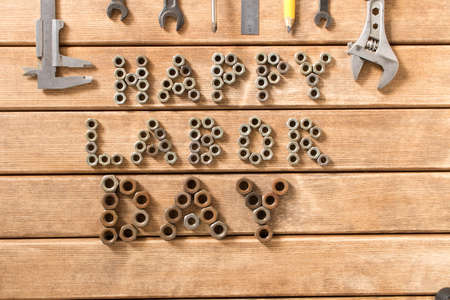 Labor day. Different tools on a wooden table