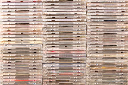 There are many different boxes with CDs . Conceptual background . Stock Photo - 100187484