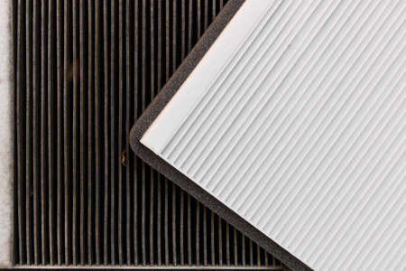 New and old car air filter. Close up Stock Photo