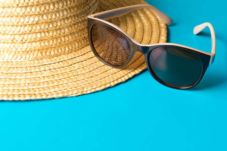 7bf99a57e58 Straw hat and sunglasses on blue background . The concept of summer. Empty  text space