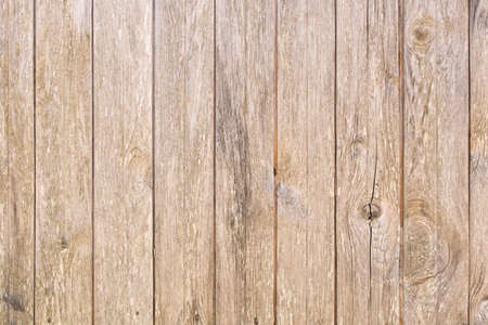 The background texture of the old wooden fence. Old wooden wall.