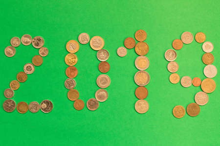 2019 is laid out of various coins on a green background. New year's eve concept. Imagens