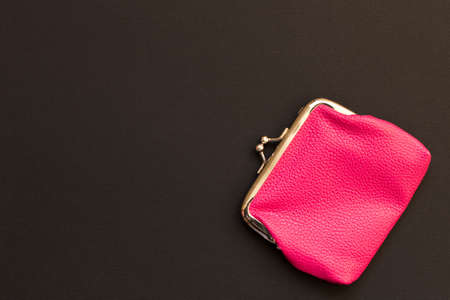 Pink wallet on black background . Close up. Top view. Stock Photo