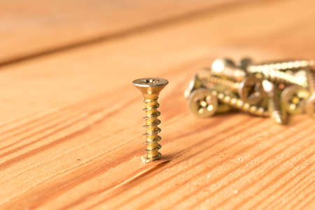 Screws on a wooden workbench. The concept of work. Reklamní fotografie