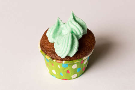 Delicious fresh cupcake. Isolated on white background. The concept of cooking with your hands. Stok Fotoğraf