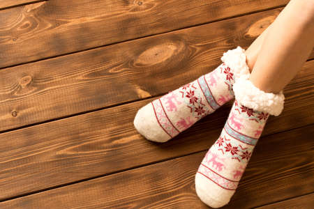 Funny warm socks on the little girl's feet.