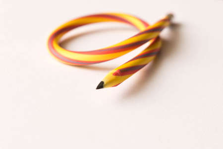 Flexible pencil . Isolated on white background. Bending pencil.