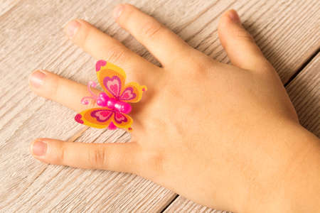 Little girls hand with a funny ring on her finger