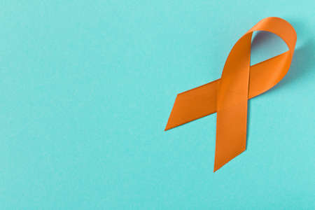 Orange ribbon. Healthcare and medicine concept. Multiple Sclerosis awareness. Leukemia awareness. Empty text space