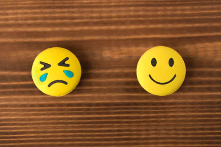 Funny smiley face on wooden background. Positive mood. Empty text space