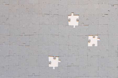 Abstract background of many puzzles. The concept of teamwork
