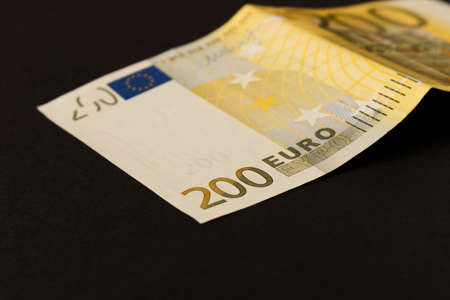 200 Euro banknote on a dark background. Close up. The concept of savings Imagens