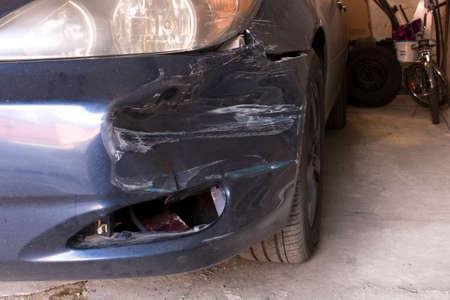 Damaged car.  Broken front bumper. The concept of road safety
