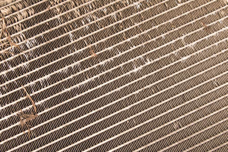 Old damaged car radiator. Abstract background texture