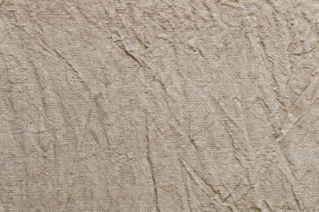 Background texture of linen fabric. Abstract background of crumpled linen fabric