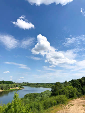 View of the river and the blue sky with clouds from the railway bridge