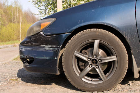 Damaged car.  Broken front bumper. The concept of road safety. Close up Stock Photo