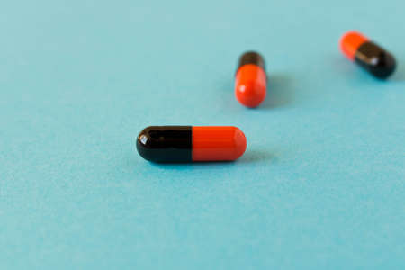 Few pills scattered on blue background . Birth control pills. Selective focus