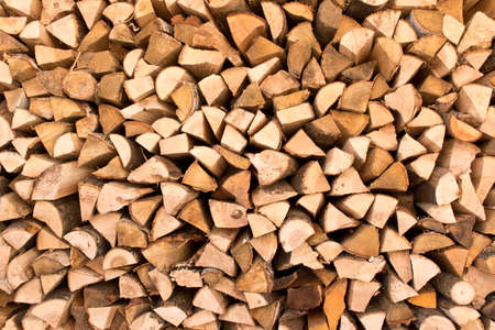 The background texture of a large pile of wood. Close up. Selective focus.