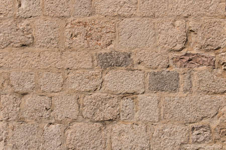 Background texture of the old fortress stone wall. Conceptual background for designers. Selective focus. Stockfoto