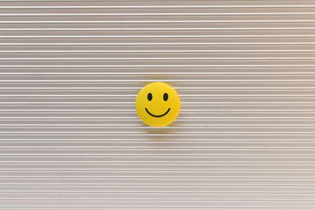 Funny smiley face on silver background. Positive mood concept. Stockfoto
