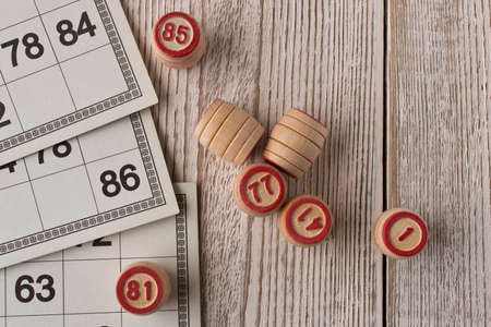 Play bingo or Lotto on a wooden table. Concept of Board games