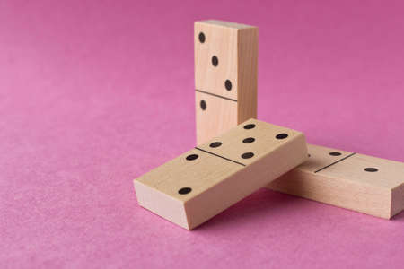 Playing dominoes on a purple background. Leisure games concept. Domino effect Stockfoto