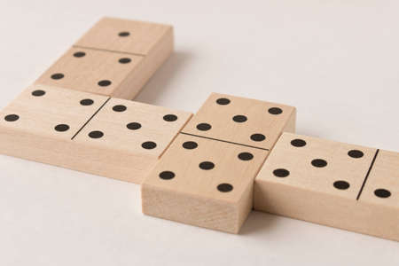 Playing dominoes on a white background. Leisure games concept. Domino effect