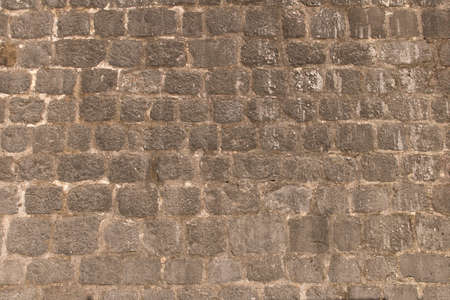 Background texture of the old fortress stone wall. Conceptual background for designers