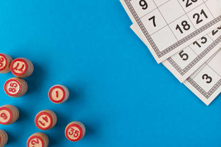 Play bingo or Lotto on a blue background. Concept of Board games