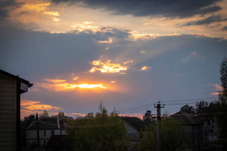 Beautiful sunset over the houses on a spring evening