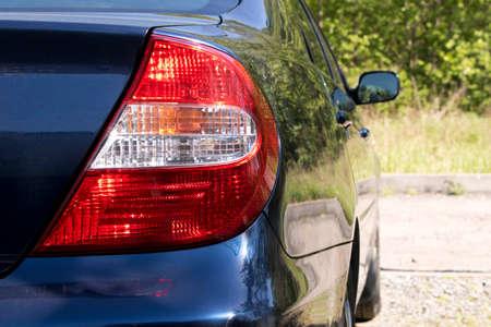 Rear light of a blue car. Close up