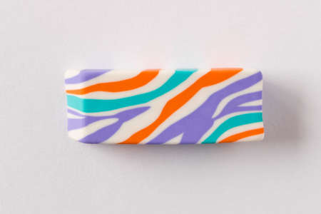 Multi-colored eraser on a light background. Close up. Selective focus