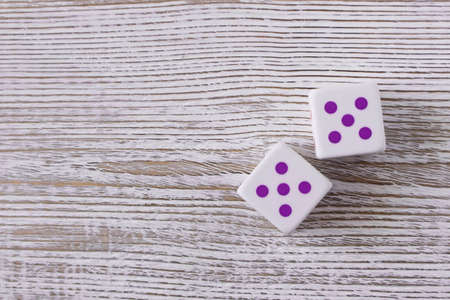 Dice on a wooden table. Close up. The concept of good luck in gambling