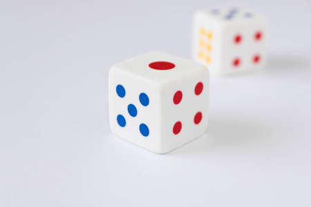 Dice on the light background. Close up. The concept of good luck in gambling