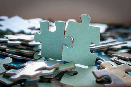Puzzle. Many puzzle pieces on the table. The concept of collective thinking
