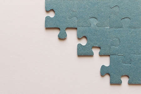 Puzzle. Many puzzle pieces on white background. The concept of collective thinking