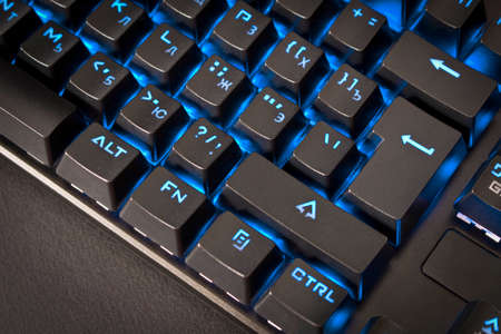 Black gaming keyboard with backlight. Close up. Selective focus 版權商用圖片 - 157605825