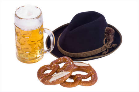 glass of german bavarian beer with breze and traditional hat
