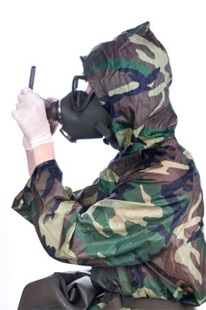 Man in a rubber hazmat holding a counter photo