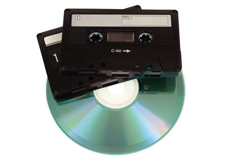 bytes: Audio cassettes with CD disk over white Background
